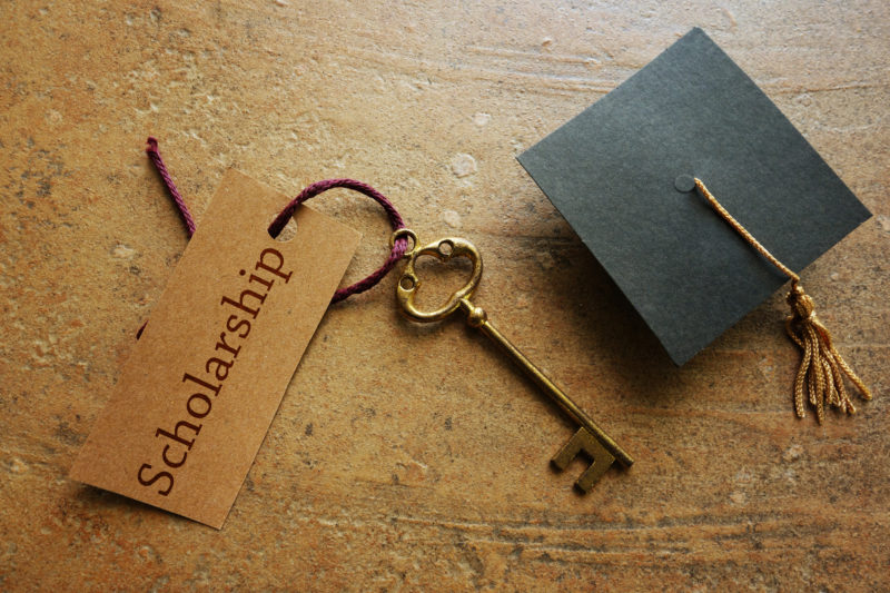 Gold key with Scholarship tag, with graduation cap