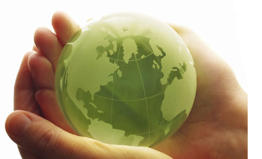 Green glass world globe in hands
