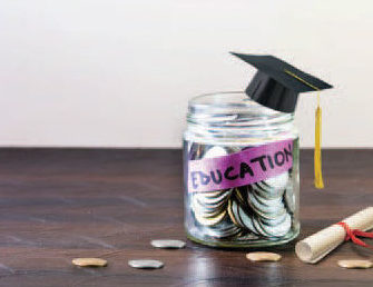 jar filled with coins with a graduation cap on top