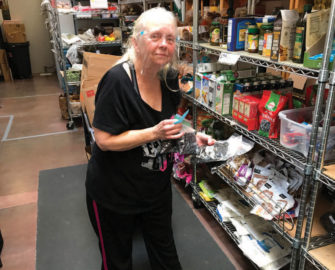 Volunteer Susan Regnerus of the Love Project works in the food pantry.