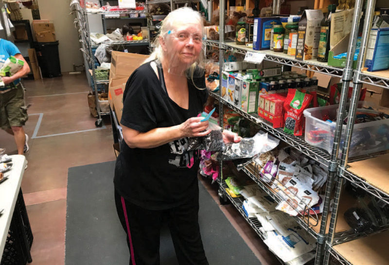Volunteer Susan Regnerus of the Love Project works in the food pantry.