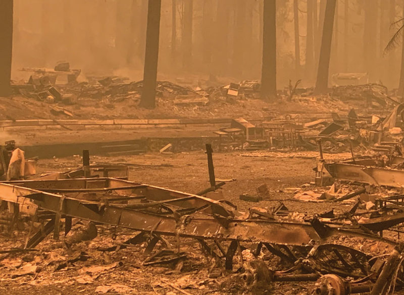 Smoky area with burned down structures.