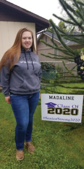Young girl in front of sign. Madaline, Class of 2020, #Senior Strong 2020