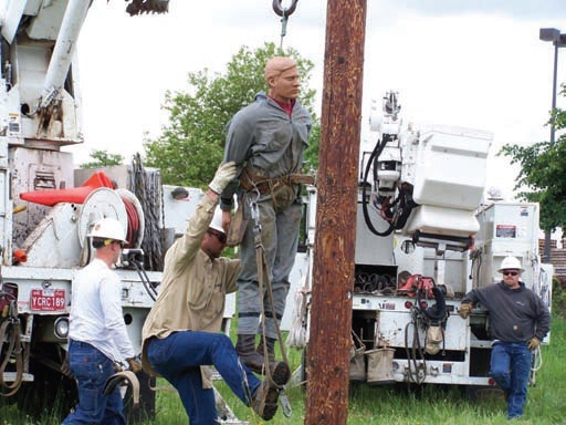 Lane Electric Cooperative linemen practice pole-top rescues in case someone is injured on the job.