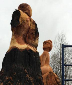 art sculptures of human forms from cedar trees