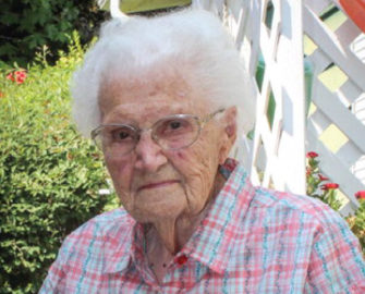 Bea Goad, 100, keeps busy playing cards with friends and doing the daily crossword.