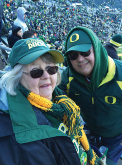 Hugh and Yvonne at a football game wearing Oregon Duck team apparel