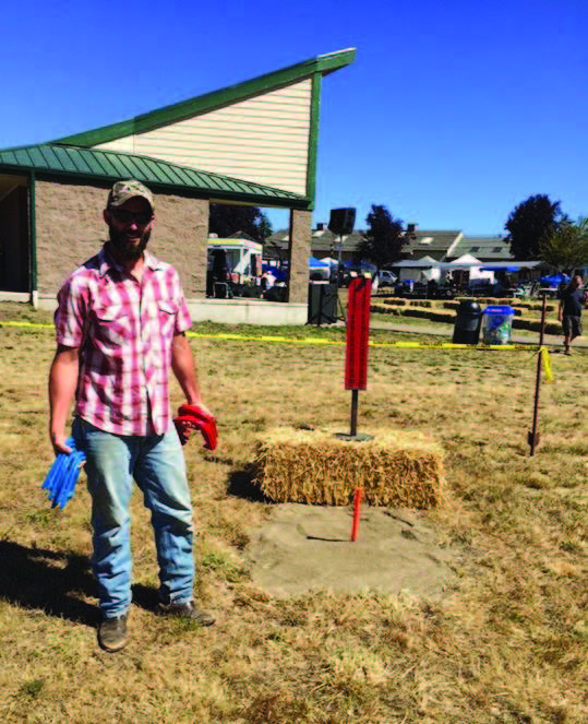 Lane Electric Cooperative fleet mechanic Brad Anderson sets up last year's horseshoe tournament.