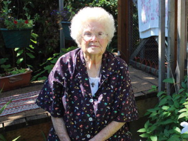 Mary Rigsby, 100, does her own cooking and cleaning, and tends to her yard and garden.