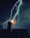 Image of lightning striking a house